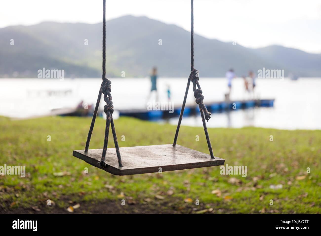 Empty swing seat, Florianopolis, Santa Catarina, Brazil - Stock Image