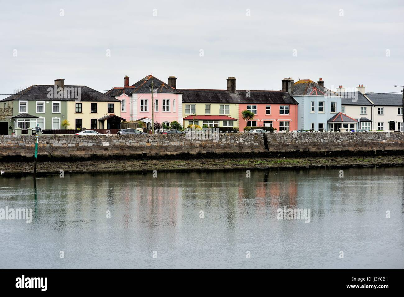 067beeed4a8bd Colorful homes and buildings lining a portion of Dungarvan Harbor in the  Irish coastal community of