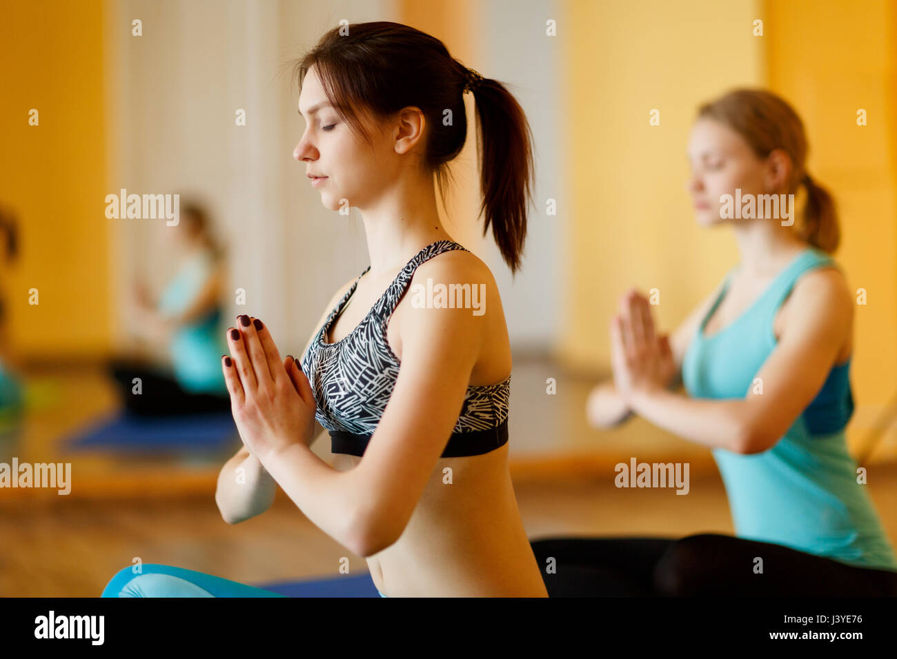 Young girls in lotus pose - Stock Image