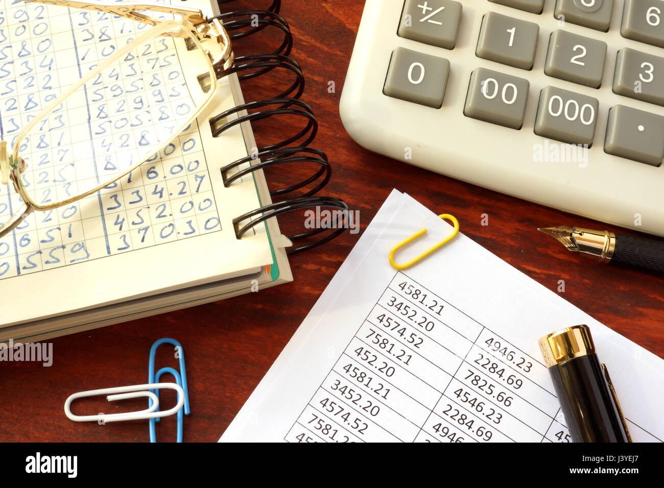 Accountability concept. Ledger with financial data and calculator. - Stock Image