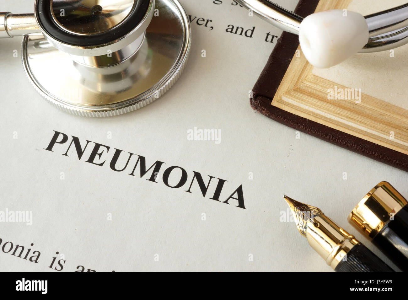 Document with word pneumonia in a hospital. - Stock Image
