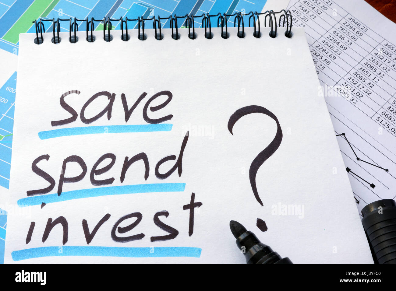 Note with words save spend invest and marker. - Stock Image