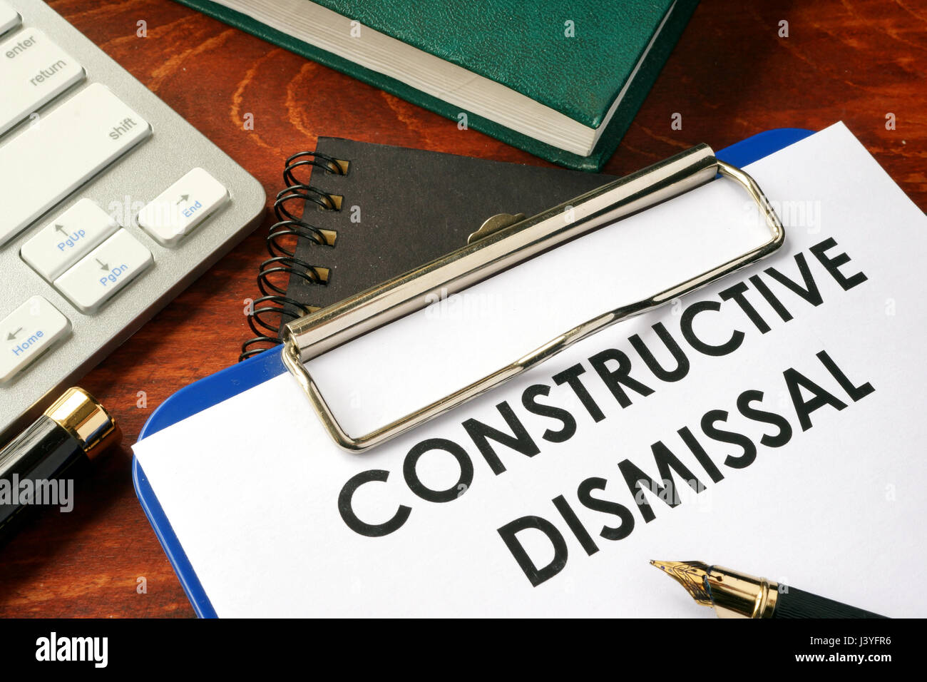 Constructive dismissal on a clipboard. Termination of employment concept. - Stock Image