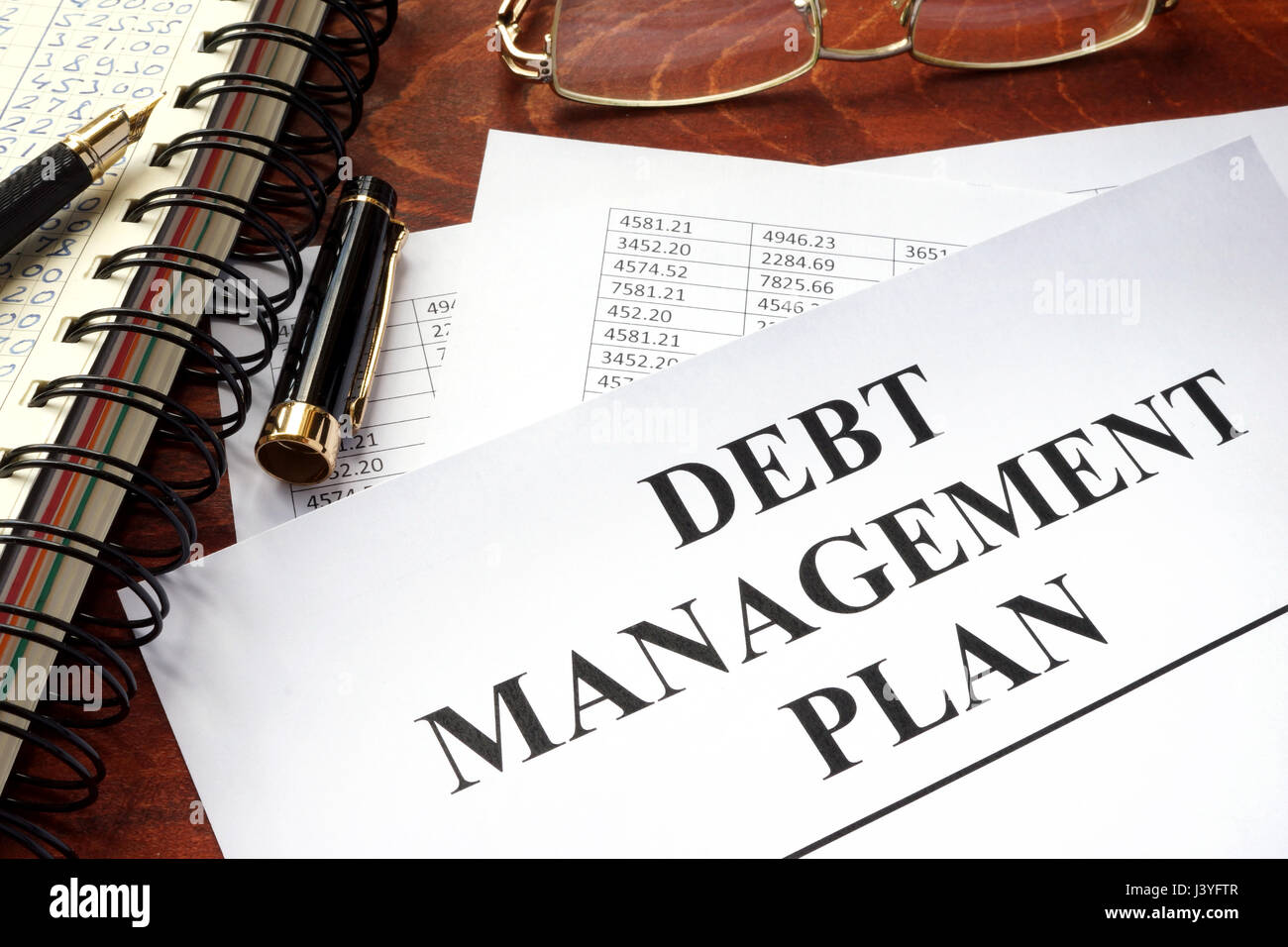 Document with title debt management plan DPM. - Stock Image
