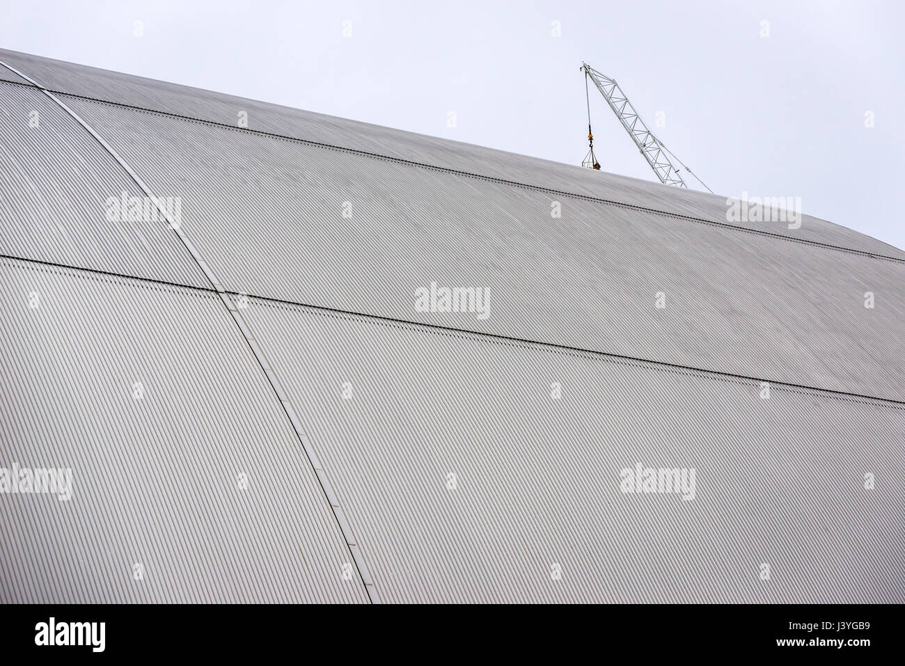Close up of New Safe Confinement structure for reactor No. 4 of Chernobyl Nuclear Power Plant, Zone of Alienation - Stock Image