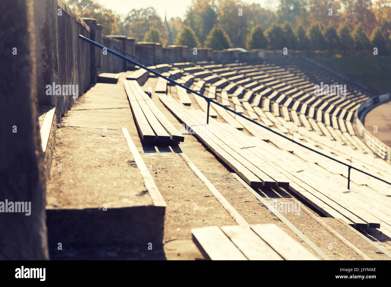 close up of bleachers with benches on stadium - Stock Image