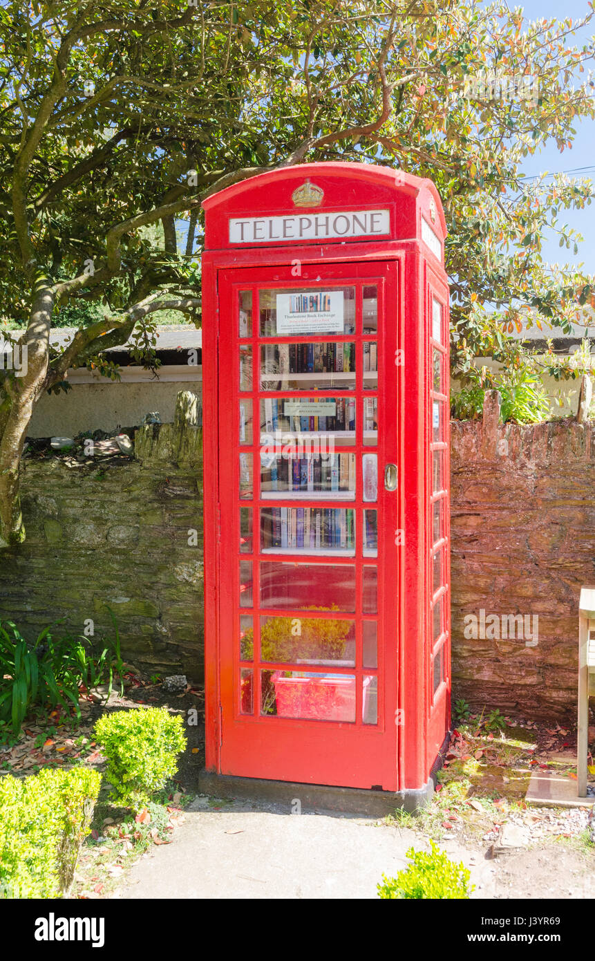 Book exchange in an old red telephone box in the South Hams village of Thurlestone - Stock Image