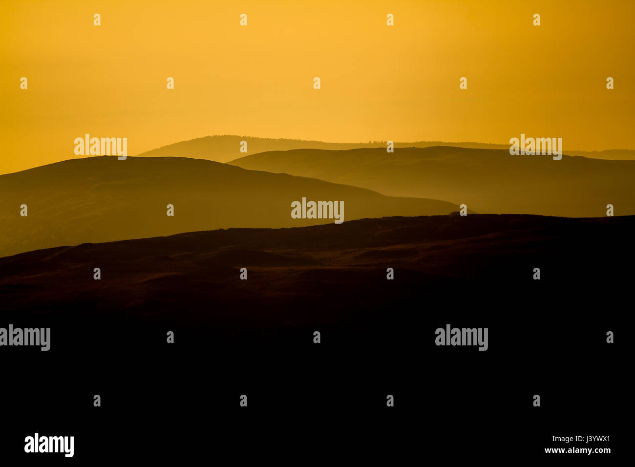 Hill in Clwyd at sunset in Spring, showing landscape recedeing in to distance - Stock Image