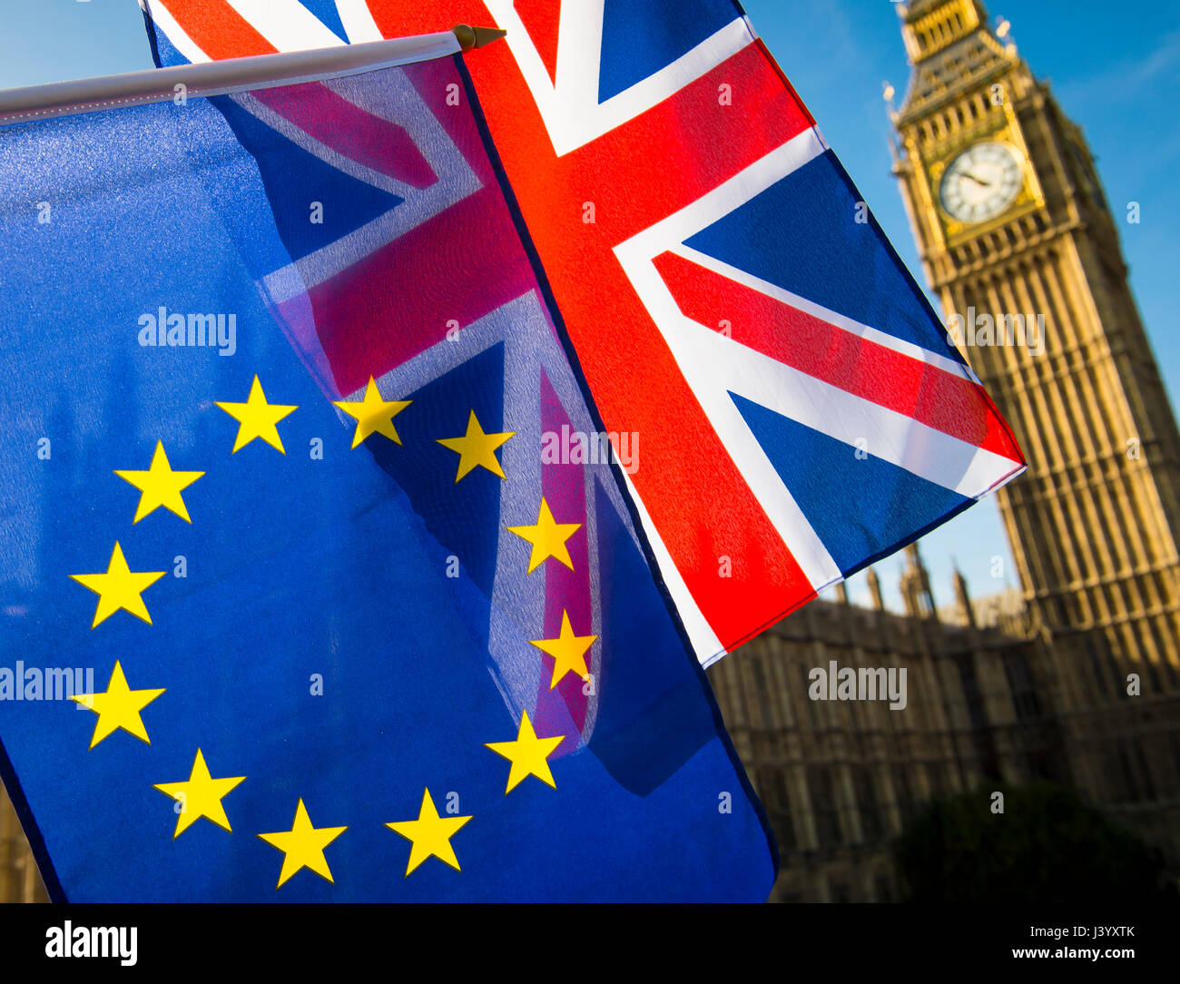 EU European Union and United Kingdom flags flying in solidarity in front of a bright morning view of Big Ben and - Stock Image