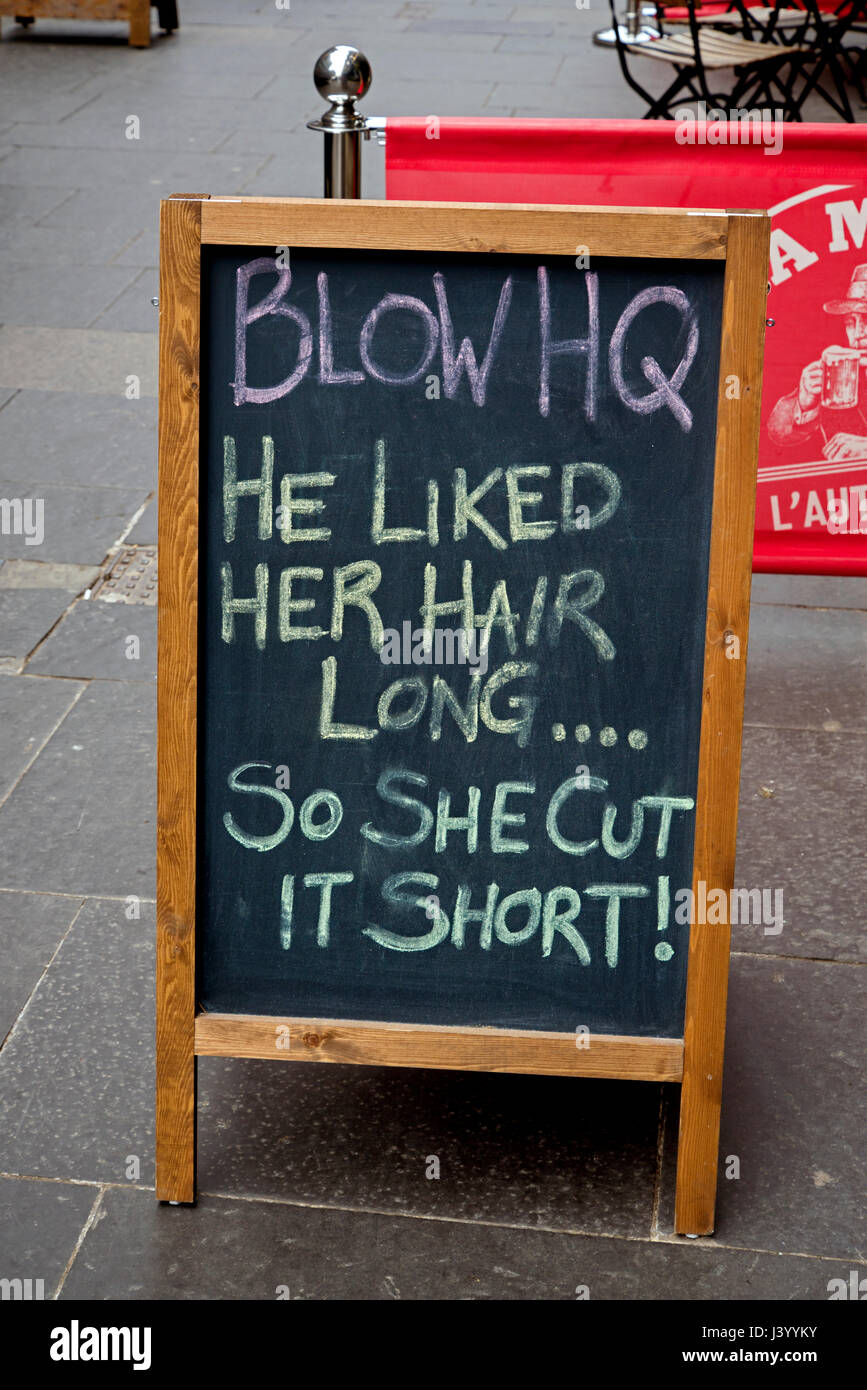 """A sign which reads, """"He liked her hair long . . . so she cut it"""