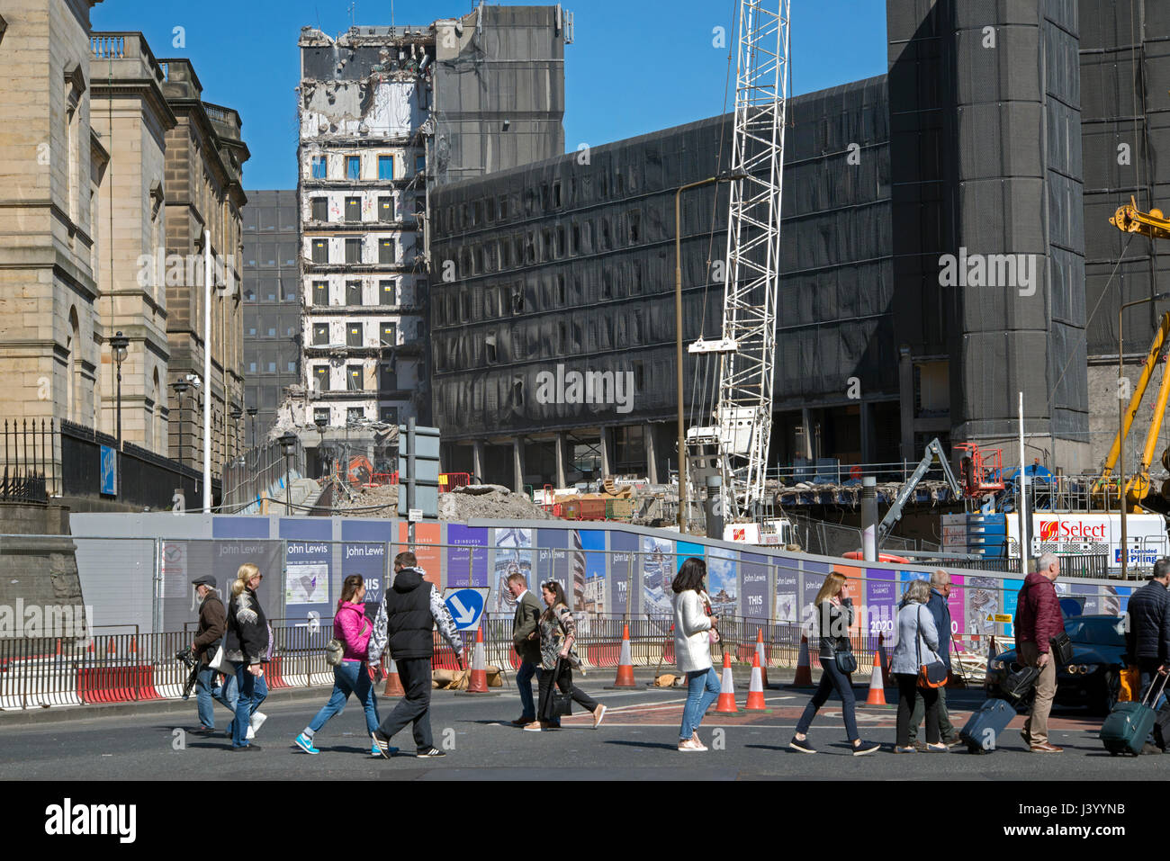 Pedestrians walk by the St James Centre which is being demolished to make way for a new hotel, shops and appartments. - Stock Image