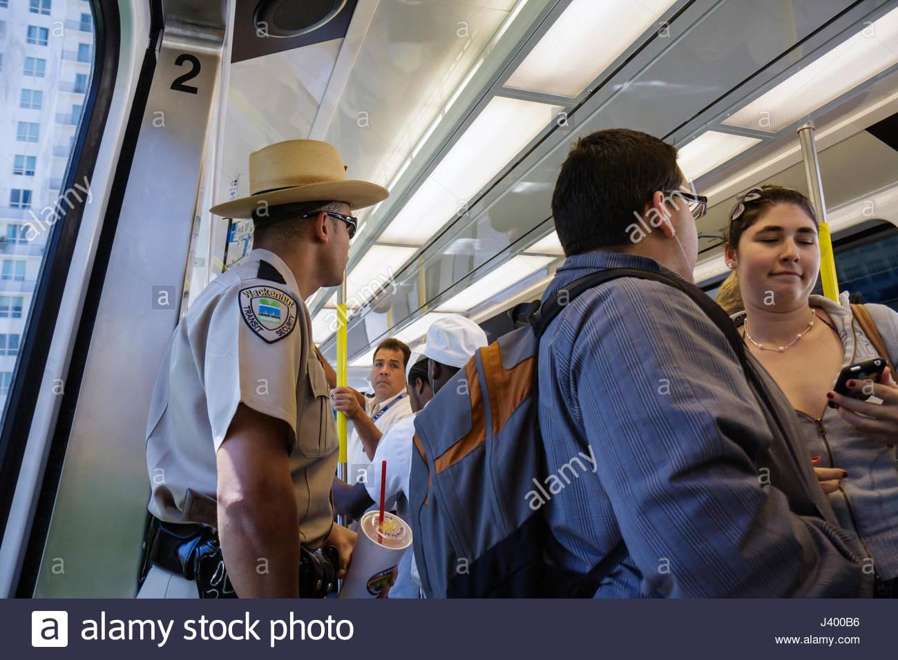 Miami Florida Metromover mass transit public transportation automated people mover Black Hispanic man woman security - Stock Image