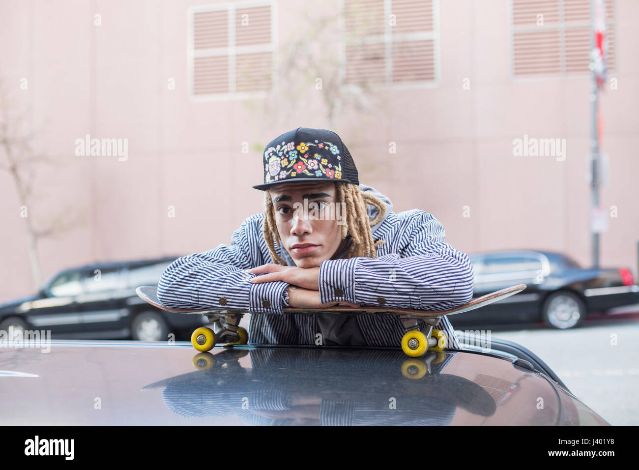 Young man skateboarding. - Stock Image