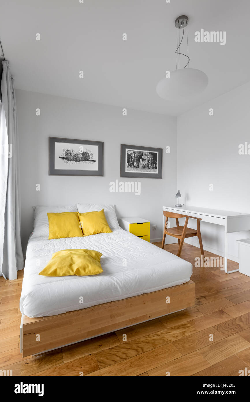 Beau Modern White Bedroom With Big Wooden Bed, Desk And Yellow Decorations