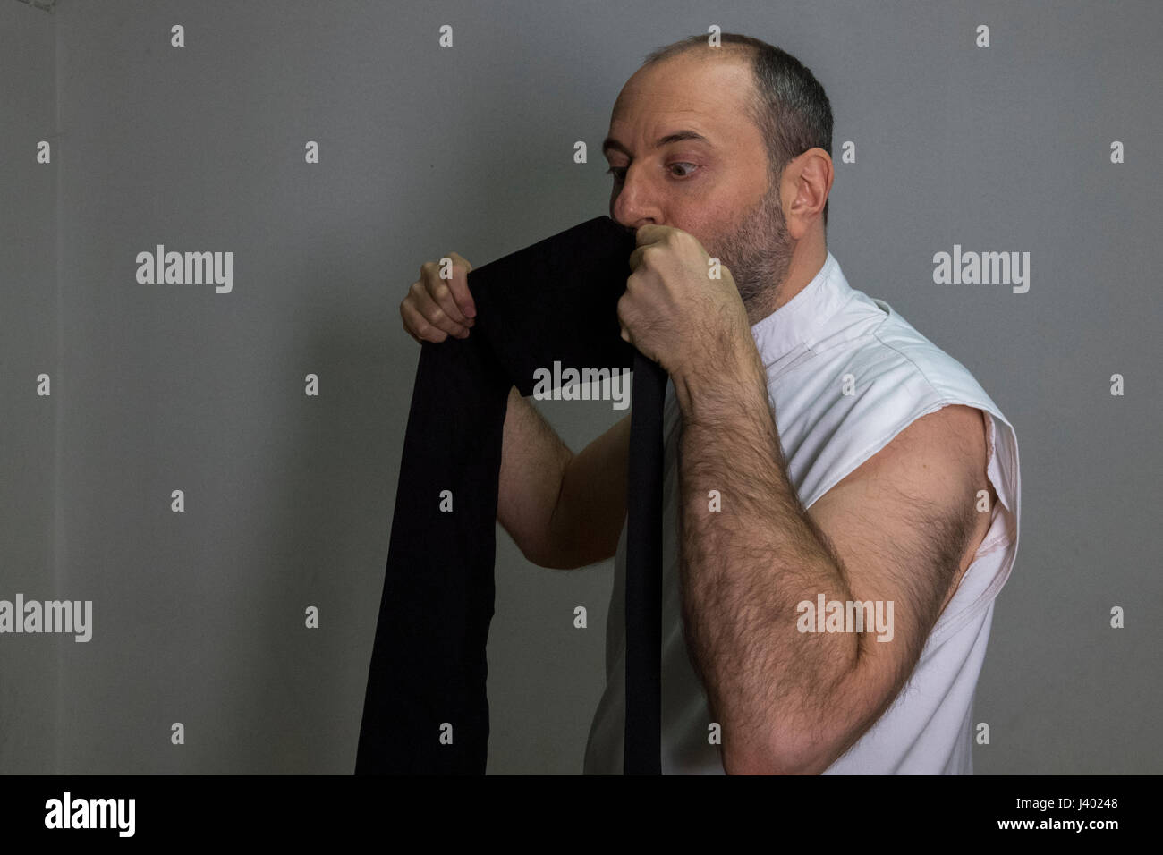 Dervish Robing, Religiously Kissing Elifi Nemed As A Sign Of Respect And Faith, waist band four fingers wide, Yaqup - Stock Image