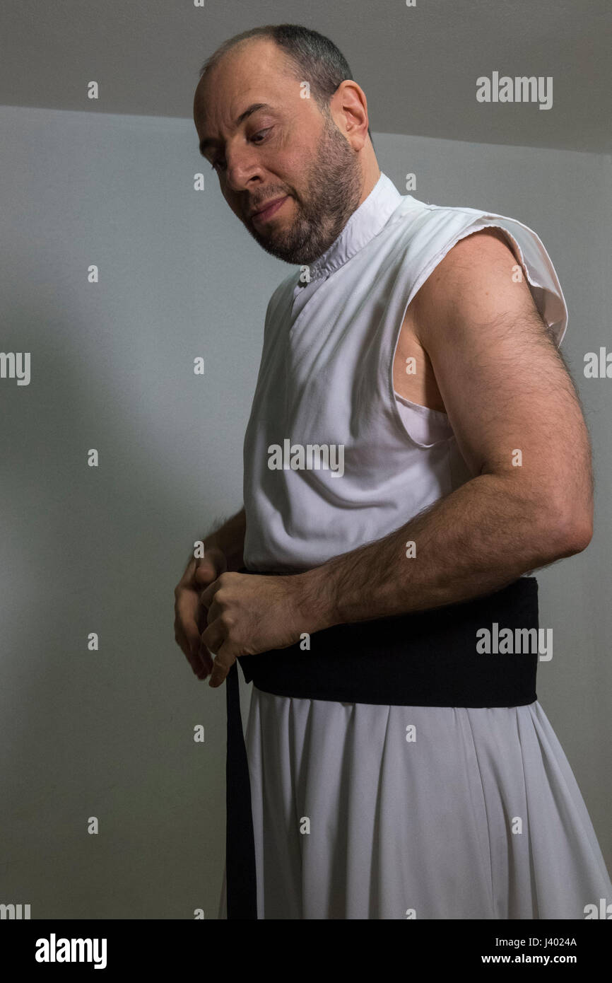Dervish Robing, Putting On Elif Nemed, waist band four fingers wide, Yaqup Baba of Fatih, Istanbul, TURKEY -  18/12/2016. - Stock Image
