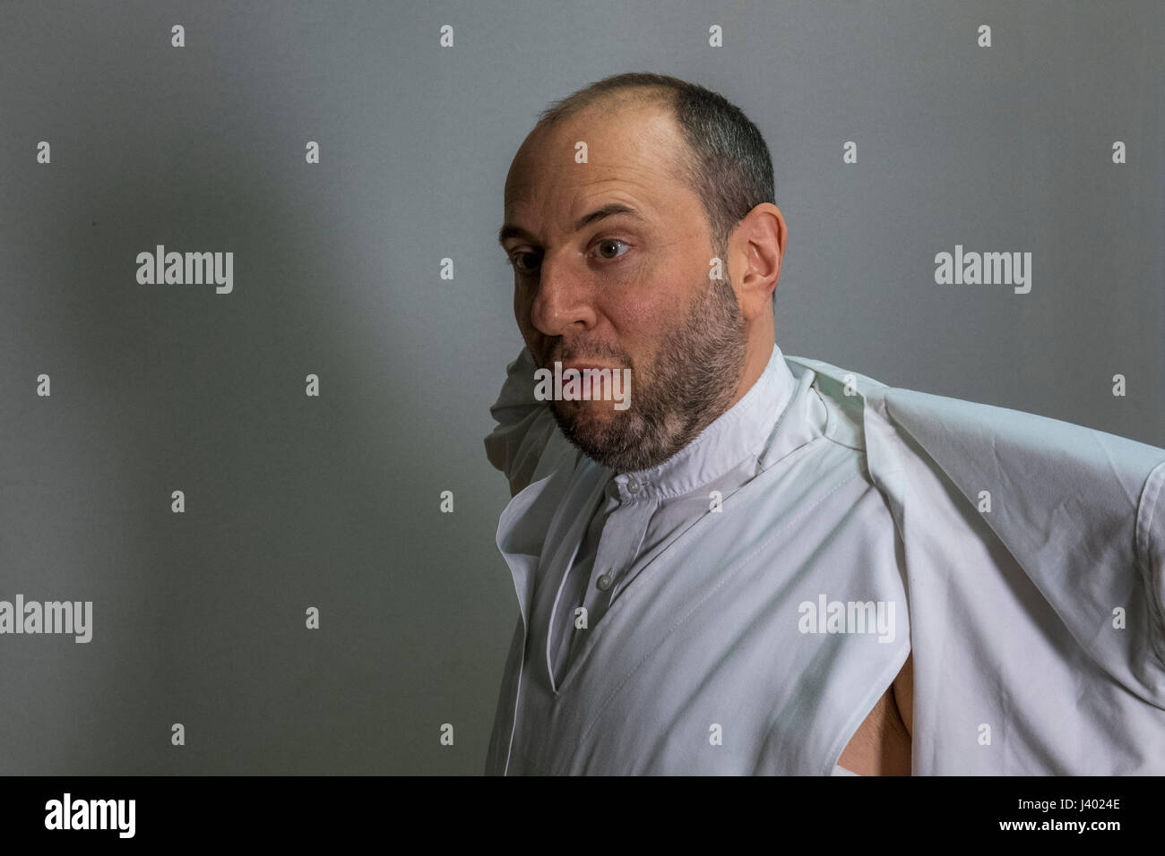 Dervish Robing, Putting On Destegul, Supported non-woven jacket worn with Tennure promoter, Yaqup Baba of Fatih, - Stock Image