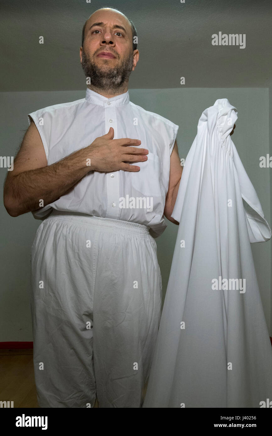 Dervish Robing, Wearing Tennure, shroud-like dress of Mevlevi Dervish, And Holding Destegul, Tennure Support without - Stock Image