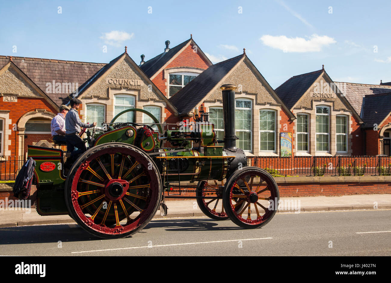 Vintage steam traction engine passing the old Sandbach council school building after taking part in the annual transport - Stock Image