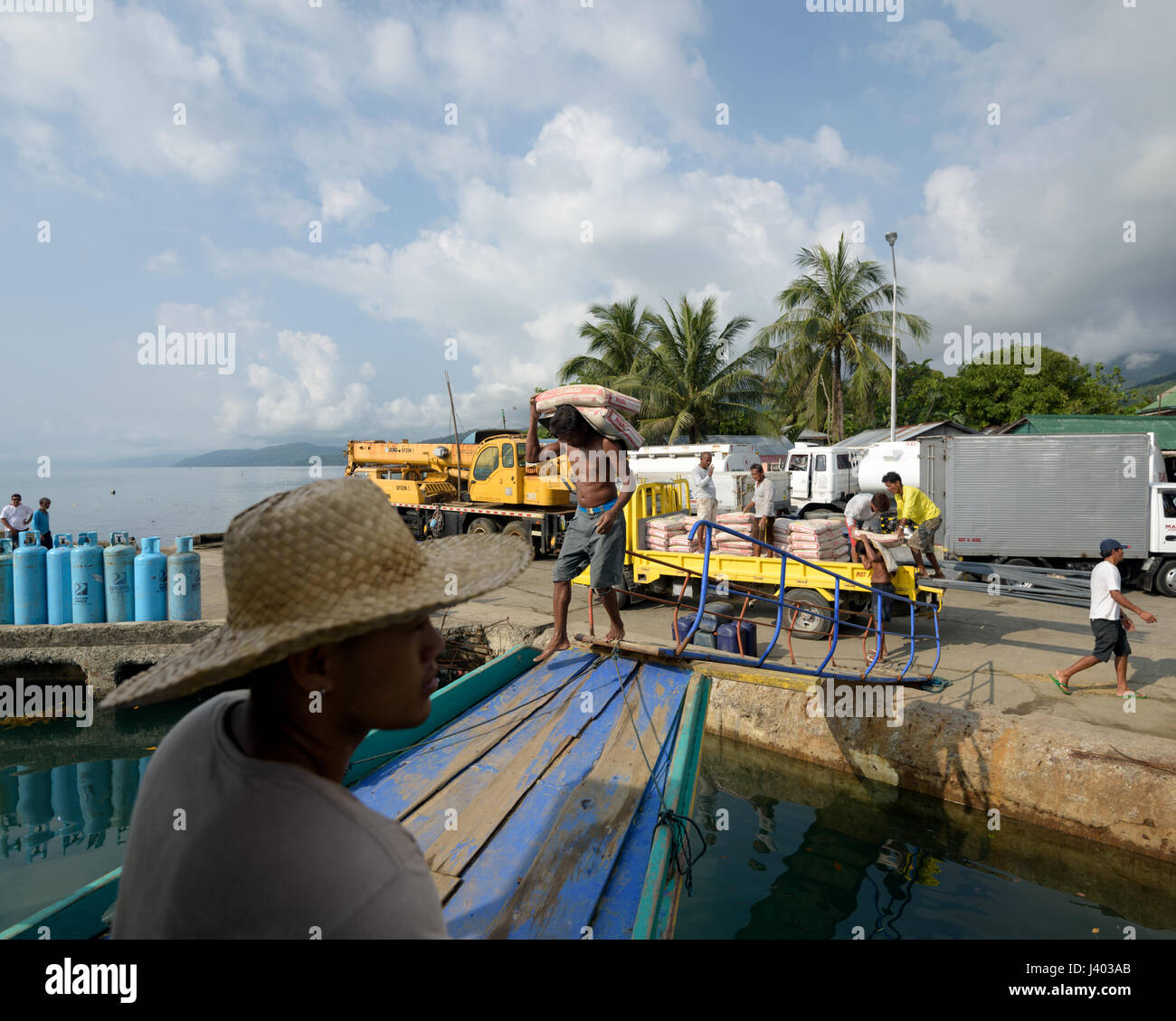 Polillo Island, Philippines - April 28, 2017: Filipino dockworkers loading a  Ferry at the Ungos Port in the Philippines. - Stock Image