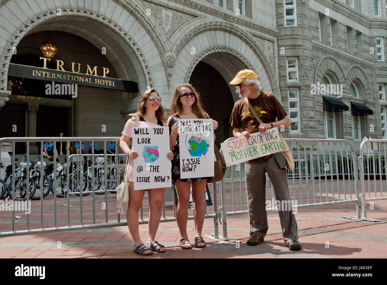 Climate change activists protesting in front of Trump International Hotel - Washington, DC USA - Stock Image