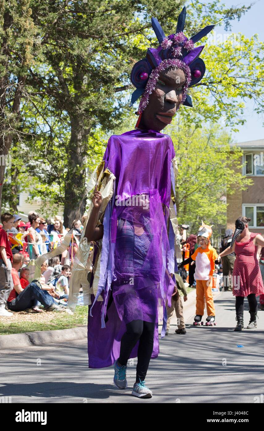A giant puppet of an African woman, at the Mayday parade in Minneapolis, Minnesota, USA. - Stock Image