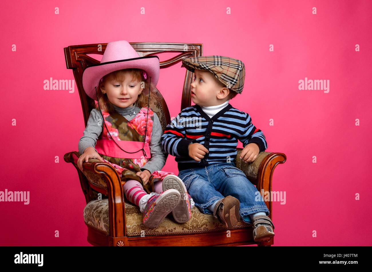 ce70516678b8c two children smiling wearing cowboy hats