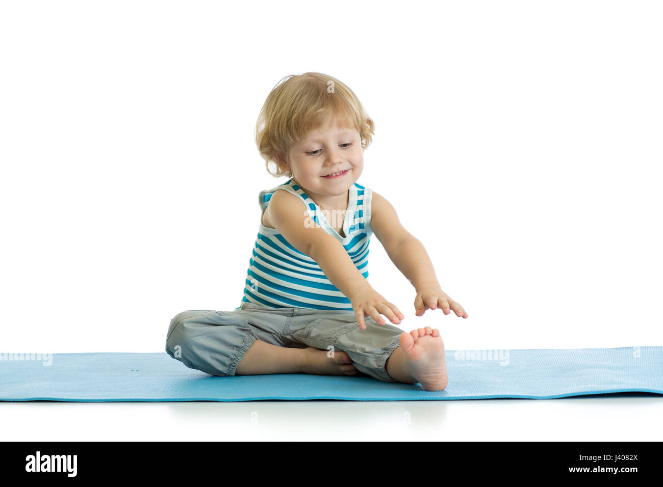 Kid child doing a set of exercises for stretching. - Stock Image