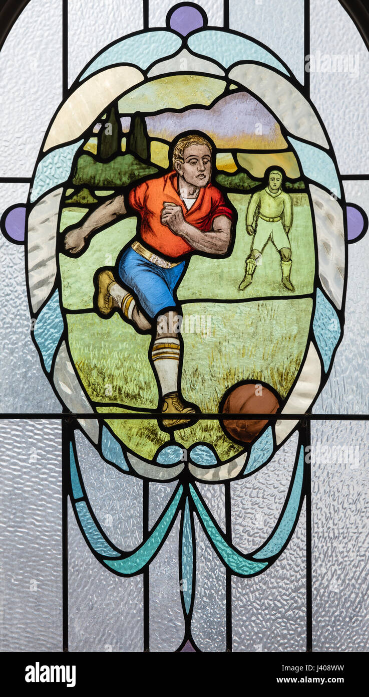 An amateur footballer, from the Edwardian era, depicted in stained glass, Victoria Baths, Manchester, England - Stock Image