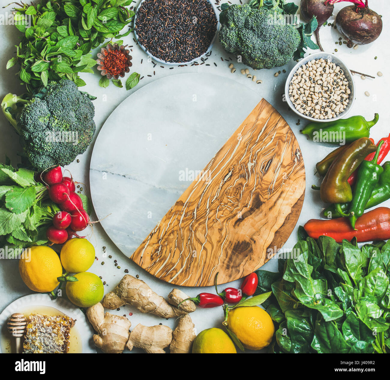 Clean eating healthy cooking ingredients with copy space in center - Stock Image