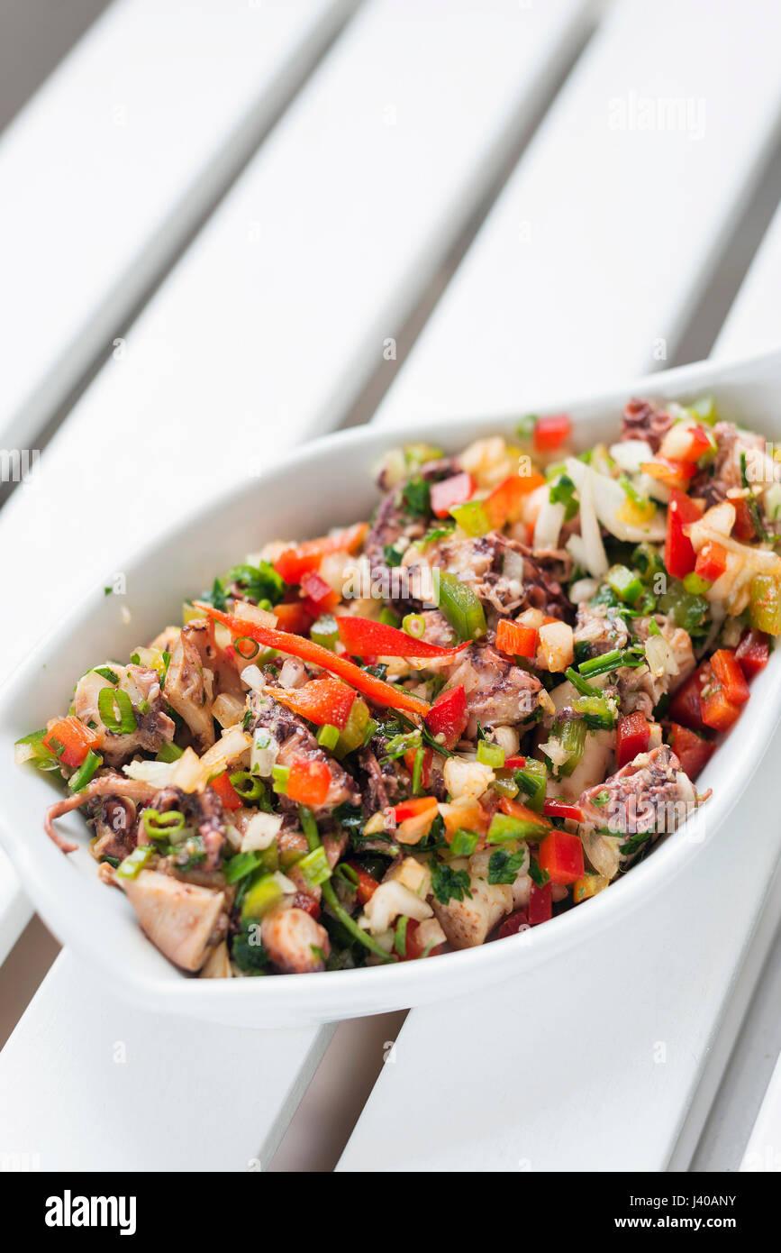 octopus fresh seafood mixed marinated vegetable salad - Stock Image