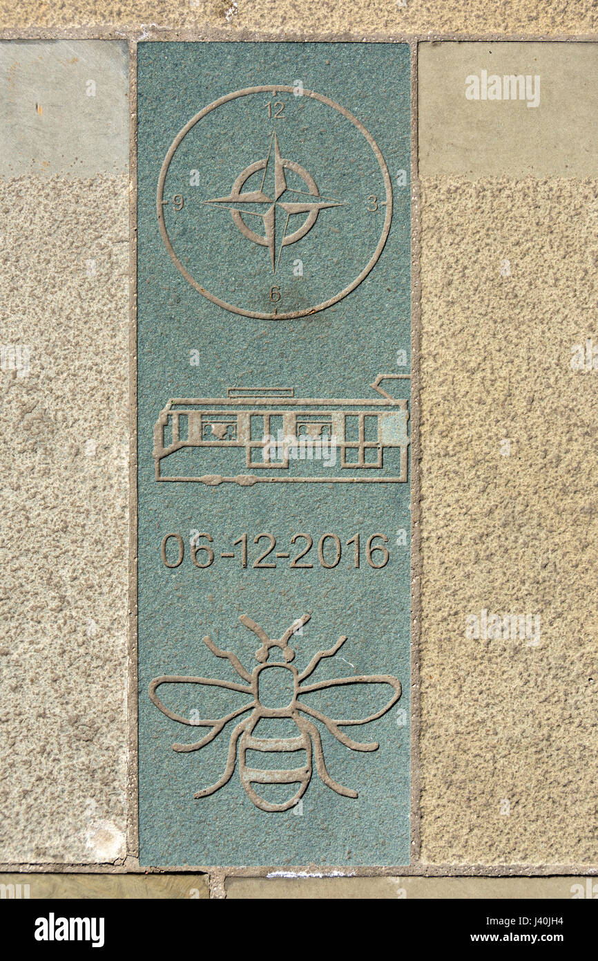 Engraved paving slab marking the position of a buried time capsule, St. Peter's Square, Manchester, England, UK Stock Photo