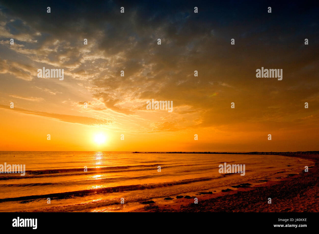 sun rise sea landscape with golden sea and clouds on sky - Stock Image