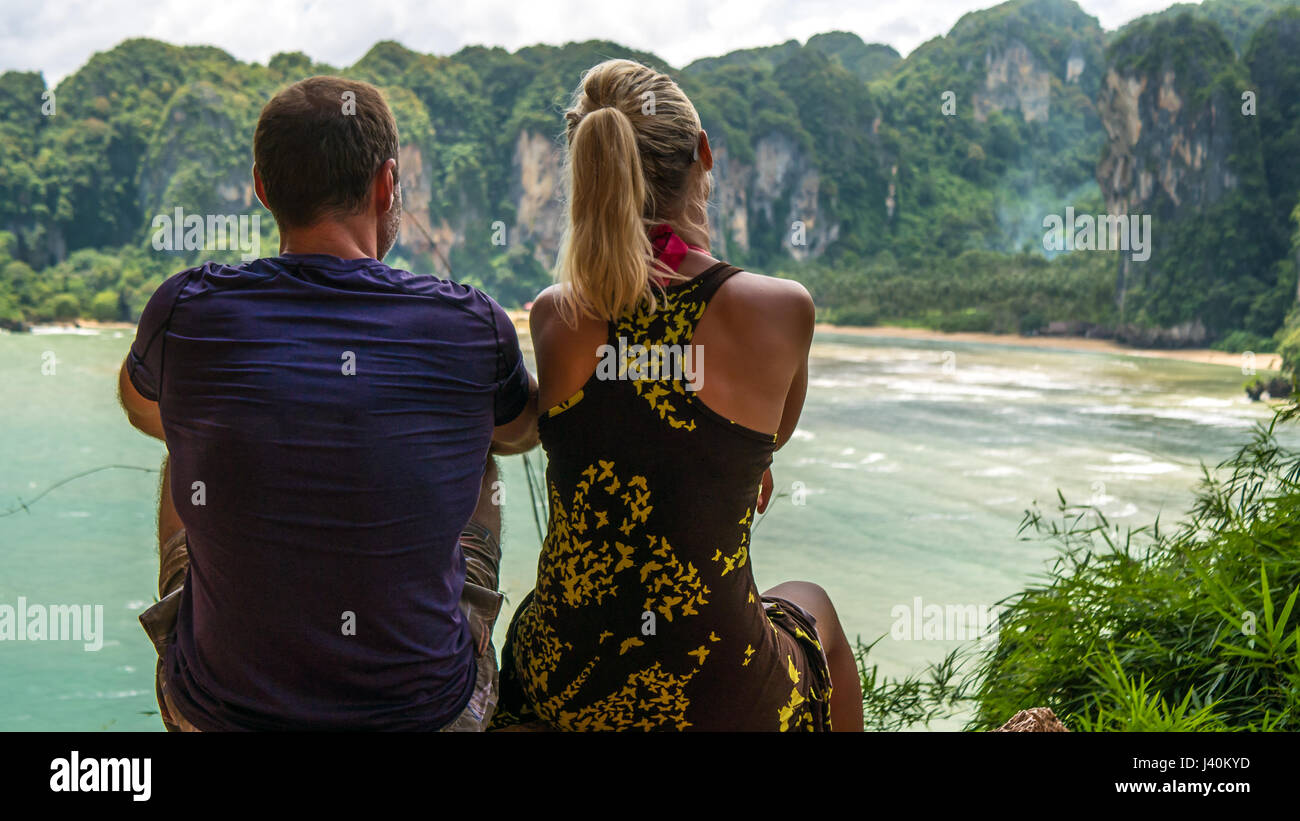 Couple on View Point to Hat Tom Sai Beach at Railay, Krabi, Thailand. - Stock Image