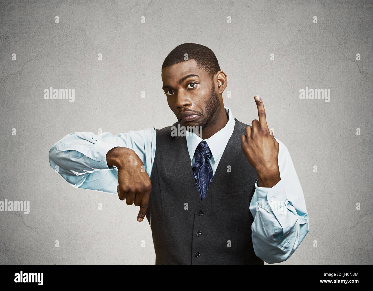 Portrait Confused Young Business Man Pointing In Two Different Directions Not Sure Which Way To Go Life Hesitant Make Decision Isolated Grey B