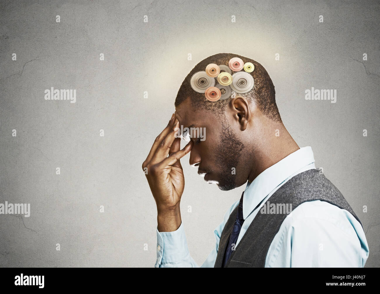 Closeup side view profile headshot thoughtful man, young guy thinking hard, gear mechanism, illustration over head - Stock Image