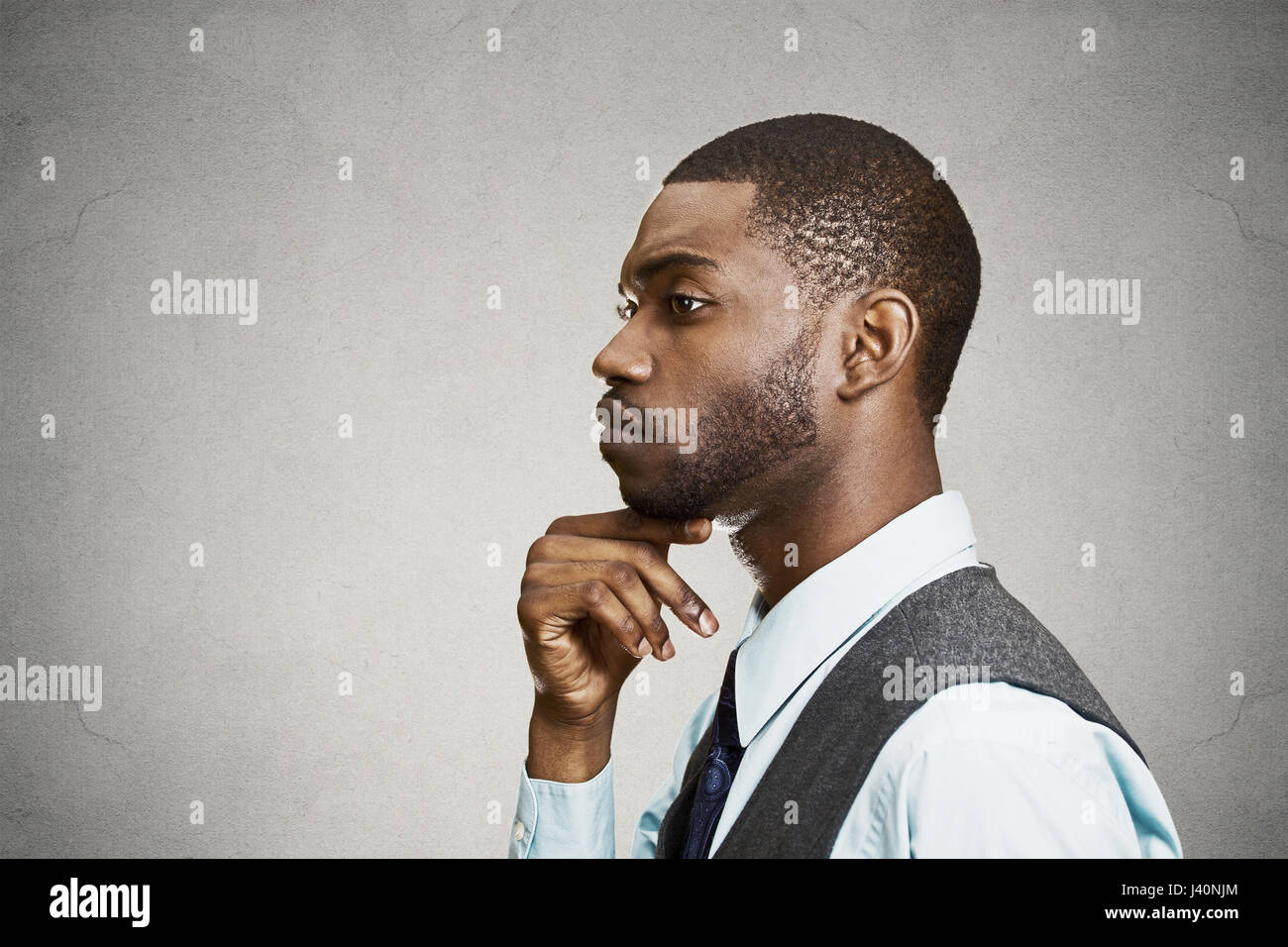 Closeup Side View Profile Portrait Headshot Young Man Daydreaming Deeply About Something With Chin On Hand Looking Down Isolated Black Background S