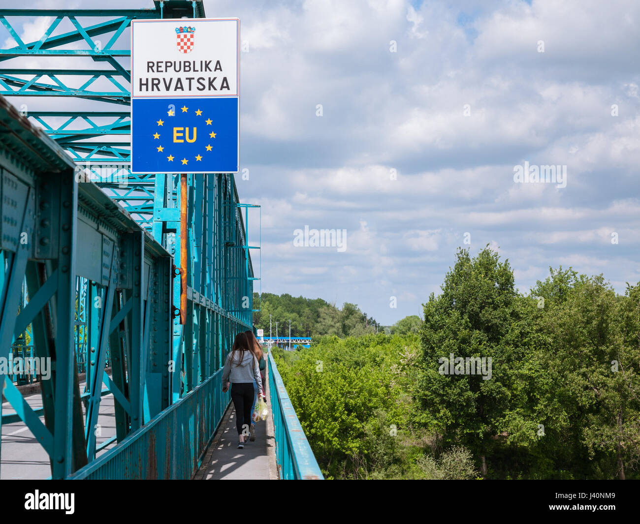 BRCKO, BOSNIA AND HERZEGOVINA - MAY 6, 2017: People entering the EU crossing the border between Bosnia and Croatia Stock Photo