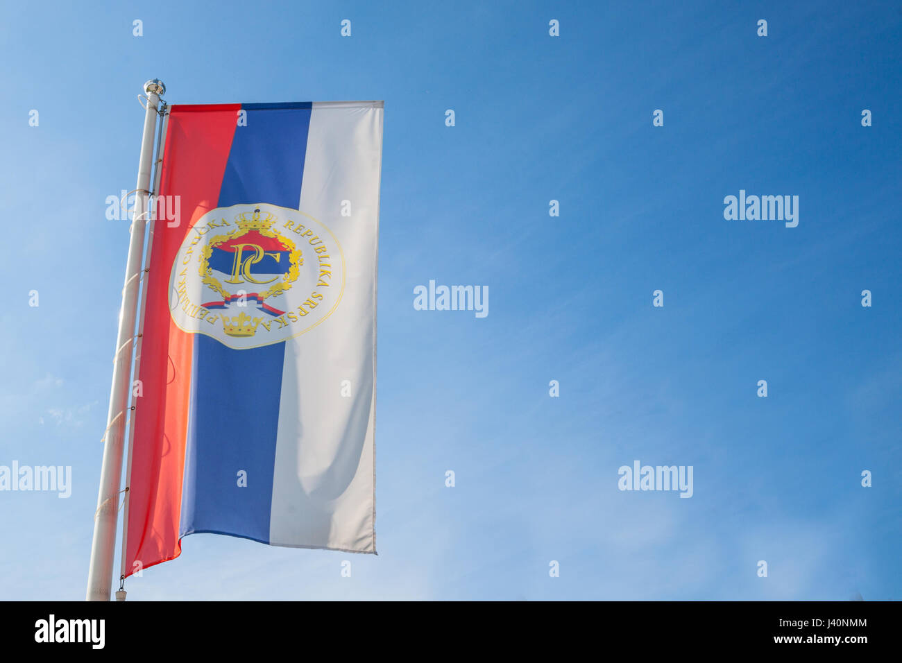 Flag of the Serb Republic of Bosnia (Republika Srpska) with its official coat of arms. The Republic of Srpska is - Stock Image