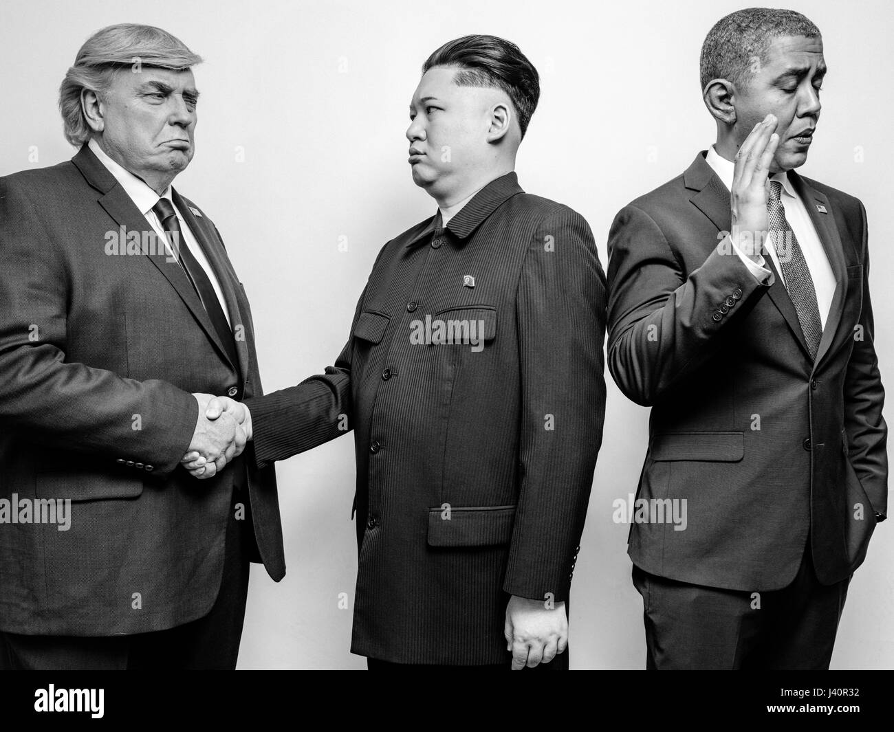 President Donald J Trump, President Barack Obama and Supreme Leader of North Korea Kim Jong-Un lookalikes meet for - Stock Image