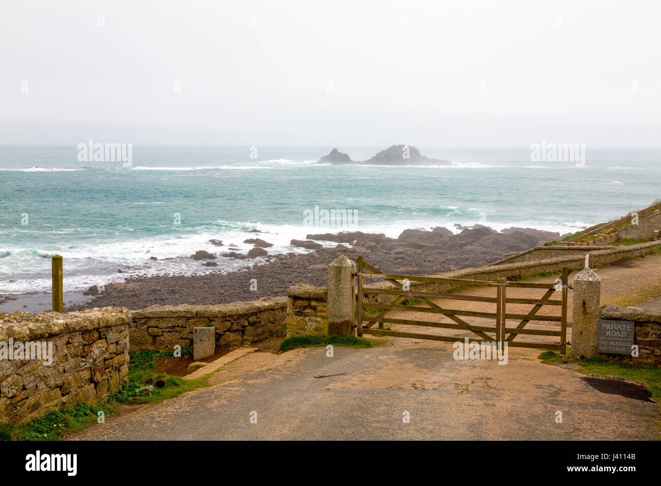 The end of the road at Cape Cornwall, Cornwall, England, UK.  Beyond are the notorious Brisons rocks, scene of many - Stock Image
