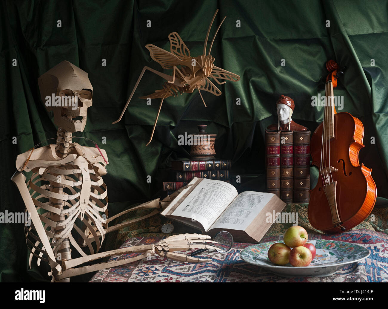 Vanitas still life with skeleton, books, violin, bust of Dante, apples on Chinese plate, gold watch, Baskerville Stock Photo