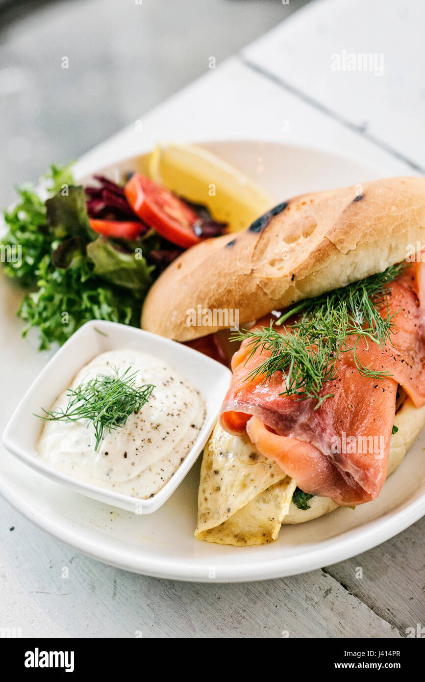 scandinavian healthy fresh smoked salmon sandwich with egg and sour cream set meal - Stock Image