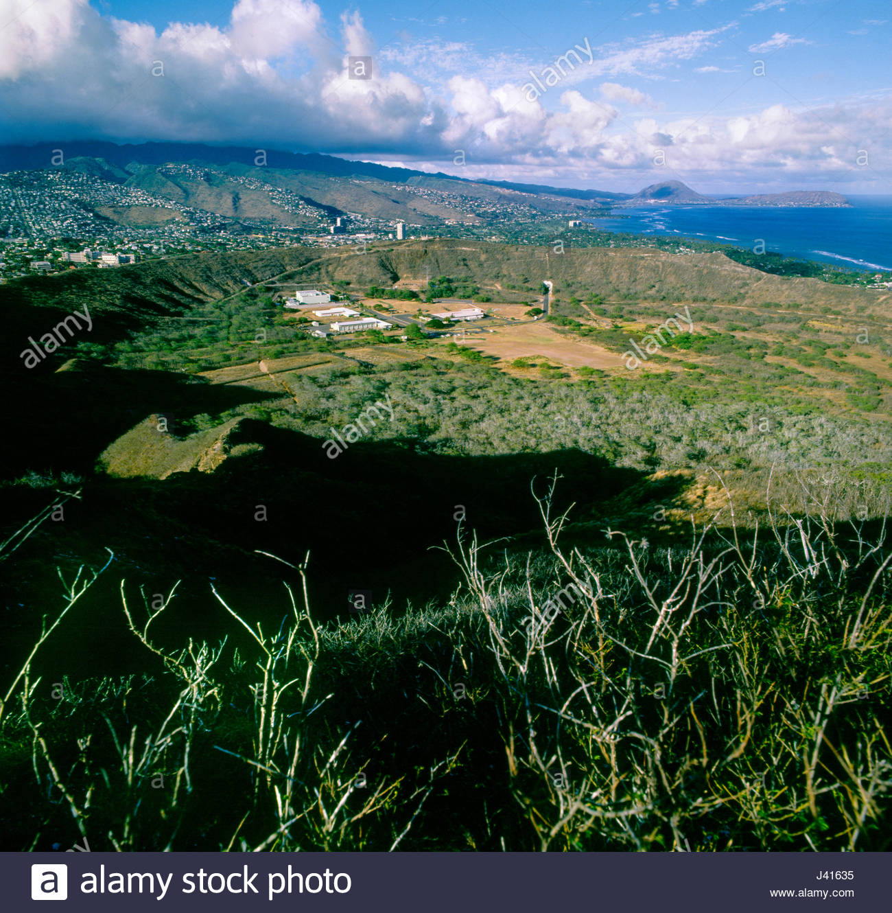 View looking West of the inside of Diamond Head crater from Le'ahi Peak, Honolulu, Oahu, Hawaii, USA. National - Stock Image