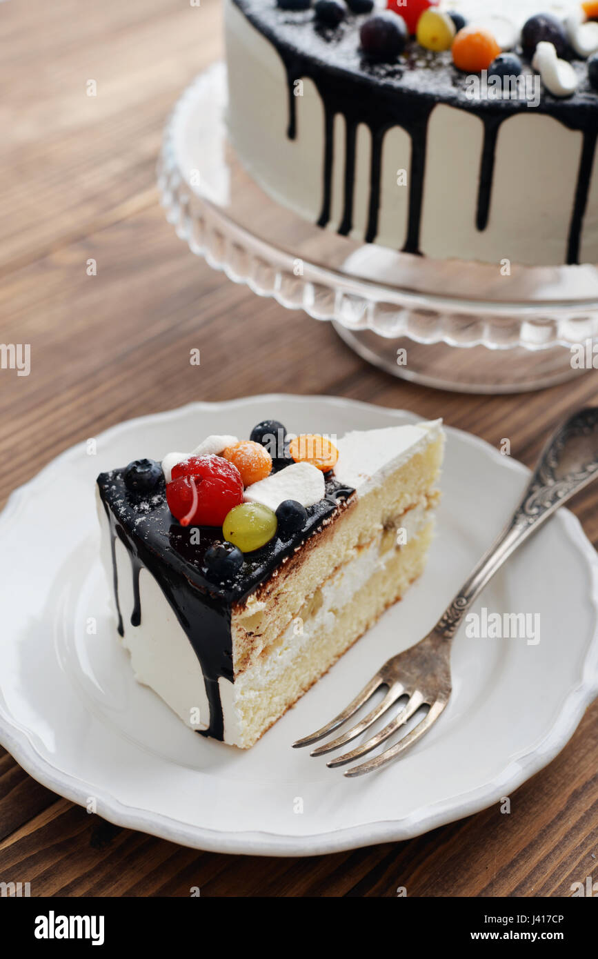 Prime Fruit Birthday Cake With Cake Slice Over Blue Background Stock Personalised Birthday Cards Akebfashionlily Jamesorg