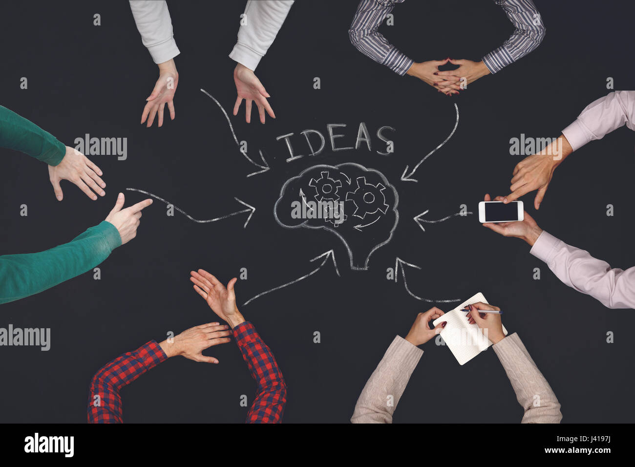 Teamwork concept - top view of six people generate ideas. - Stock Image