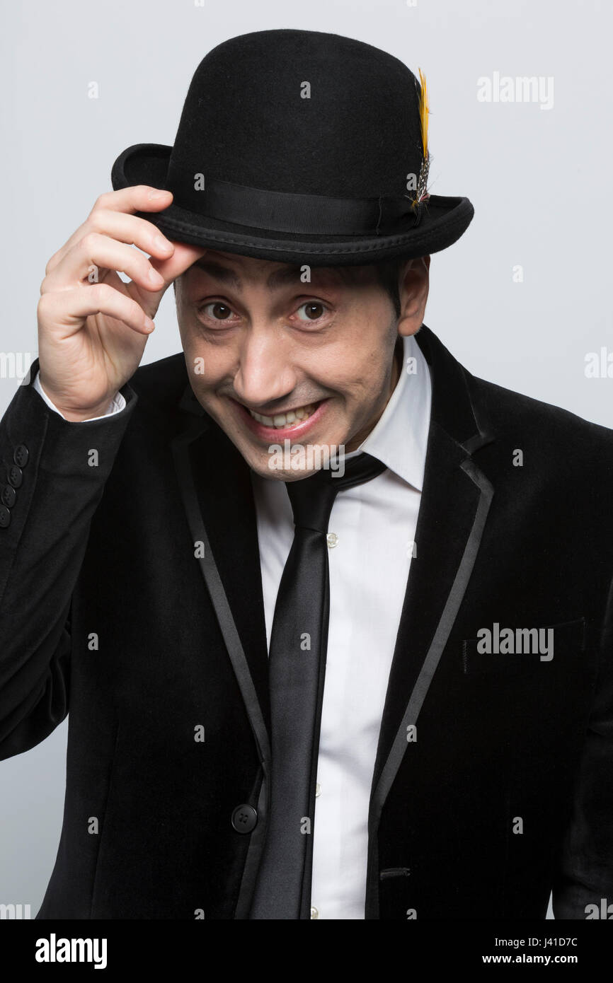 5e68074bfcd Portrait of man wearing a black bowler hat and a black suit Stock ...