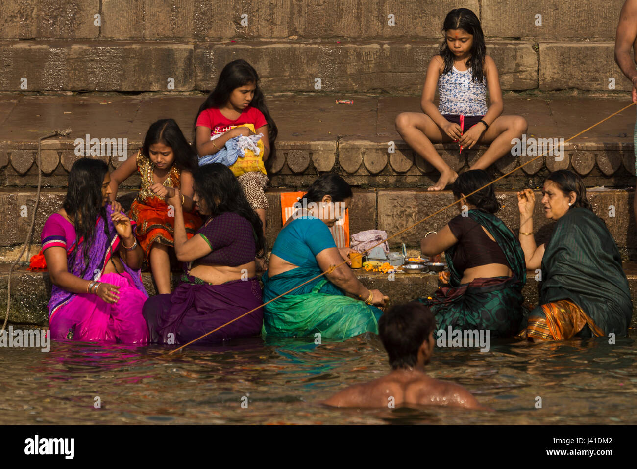 0abd78a16b9 Women bathing in the sacred waters of the Ganges river. Varanasi, India -  Stock