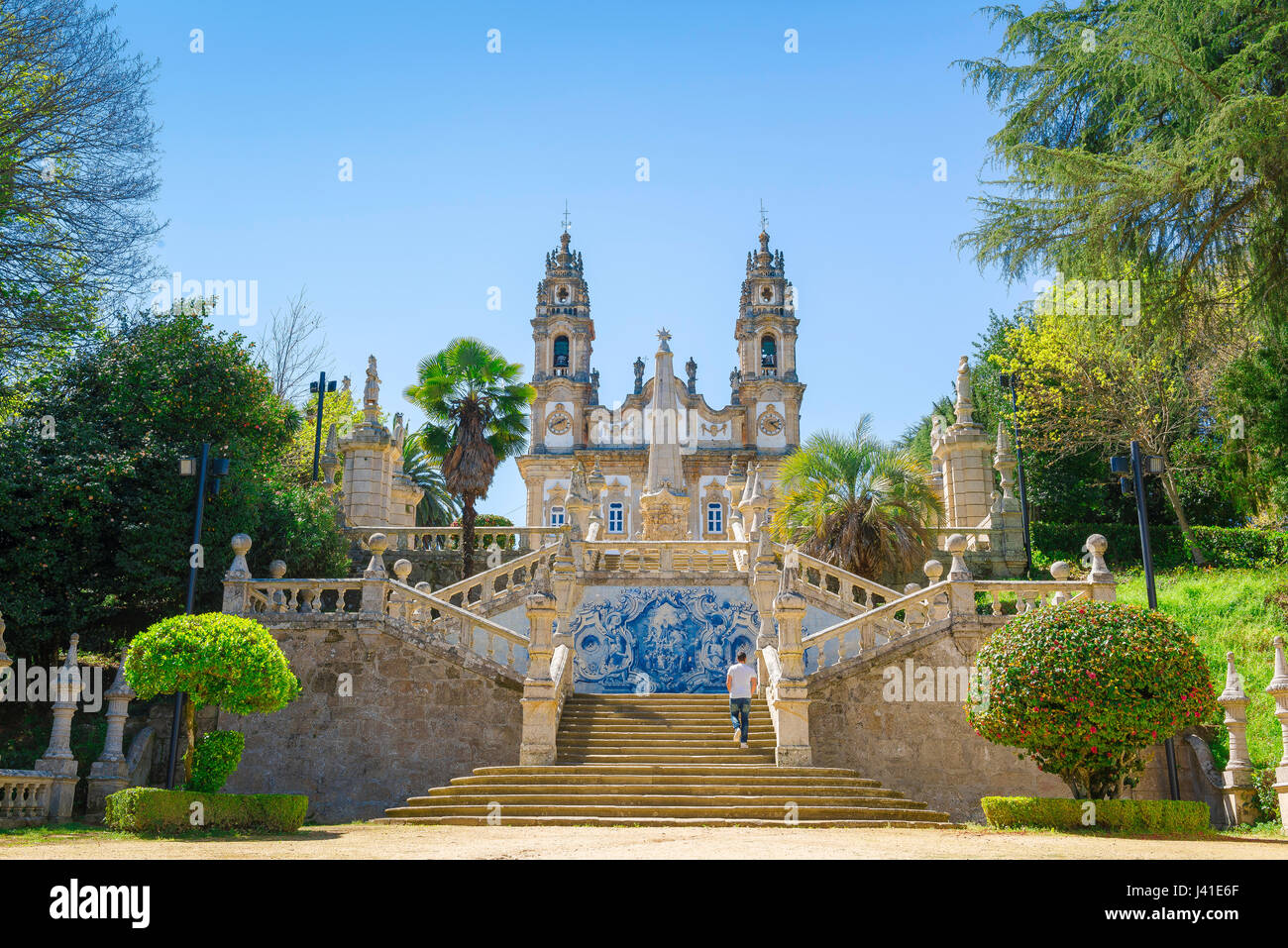 Lamego Portugal stairs, a man climbs the 686 steps of the Baroque stairway leading to the church of Nossa Senhora - Stock Image