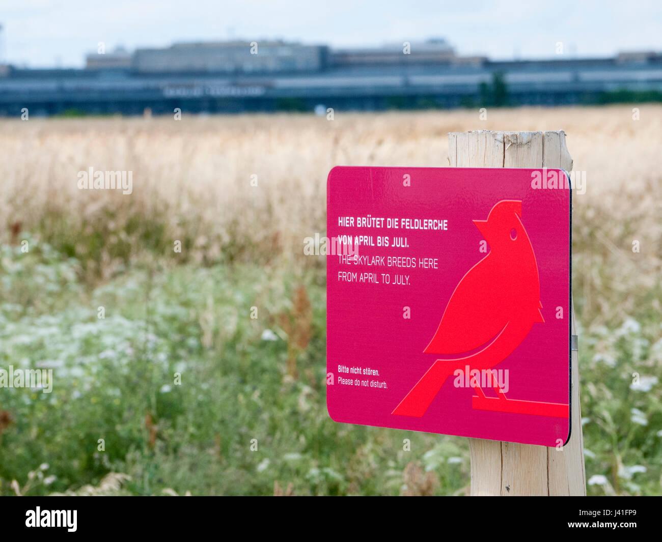 Sign warning of breeding Skylark birds at Tempelhofer Park , former Tempelhof Airport in Berlin Germany - Stock Image